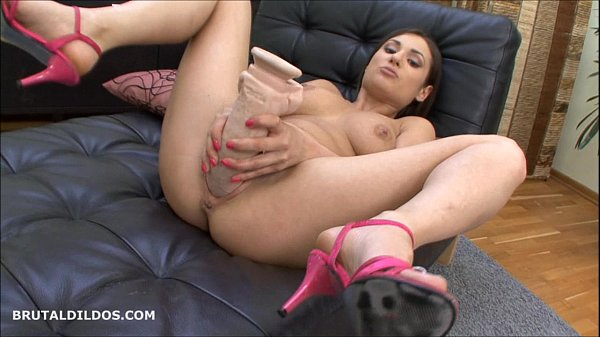 Cute brunette fills her pussy with a brutal dildo